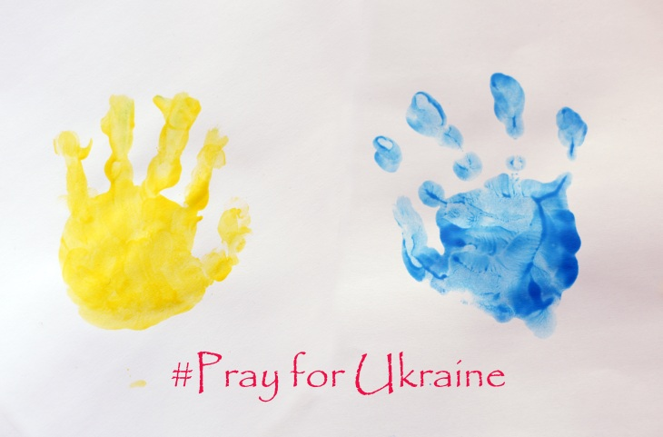 Child's handprints symbolizing Ukrainian flag